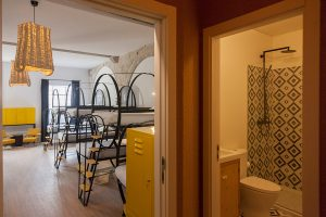 14 people dorm room with private bathroom at The House of Sandeman Hostel & Suites