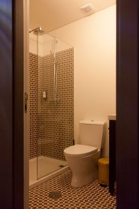 Private bathroom of one of the hotel rooms at The House of Sandeman Hostel & Suites