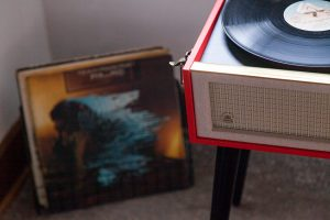 Vinyl records and turntable in hotel room